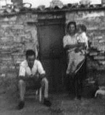 José Agudo and Rosario in front of their shack